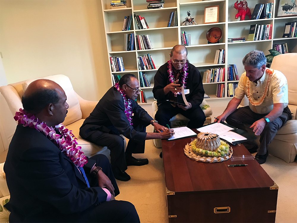 West Papua delegation signs mou with UHM President David Lassner