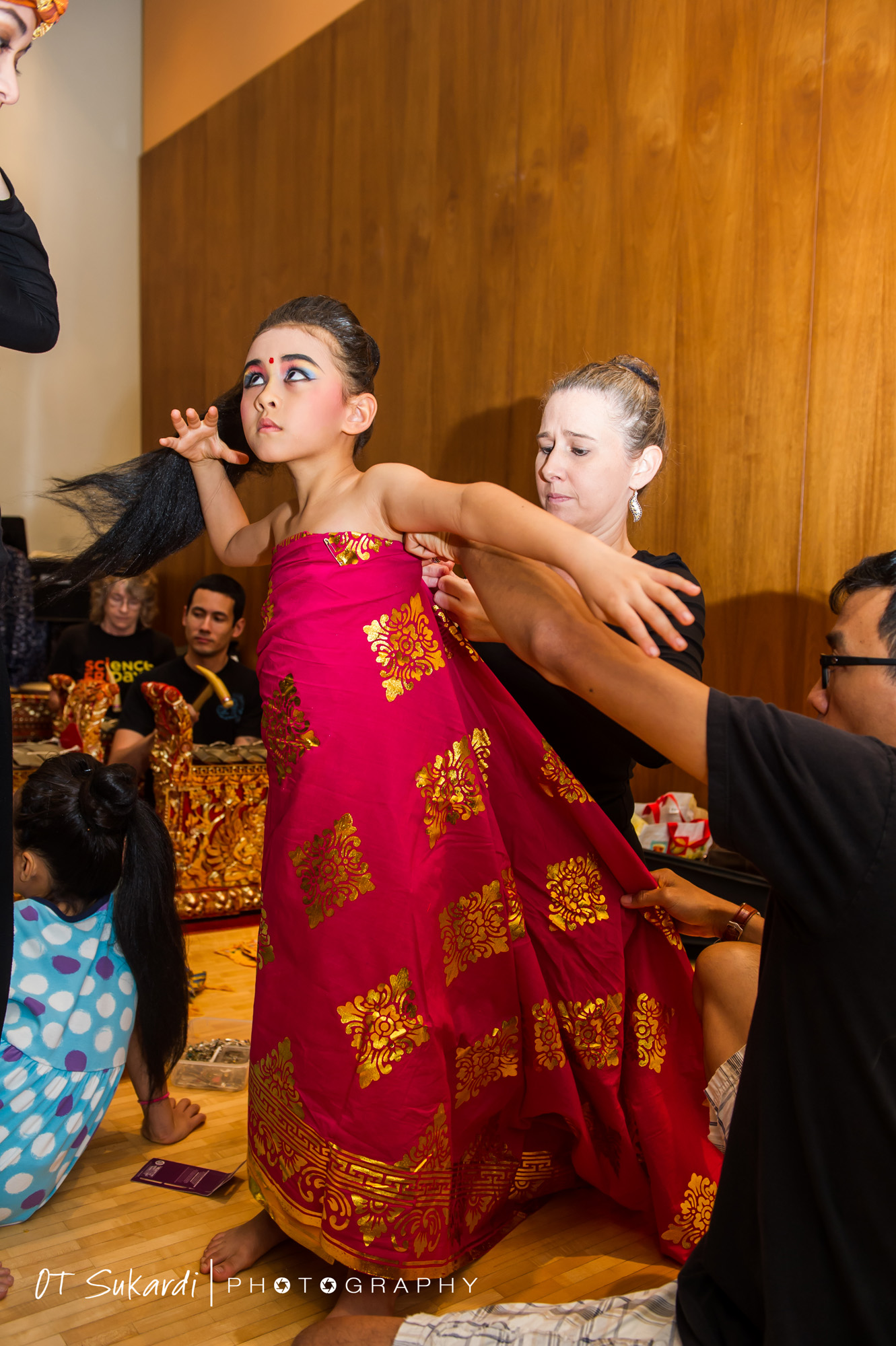 Young performer is dressed in pink sarong