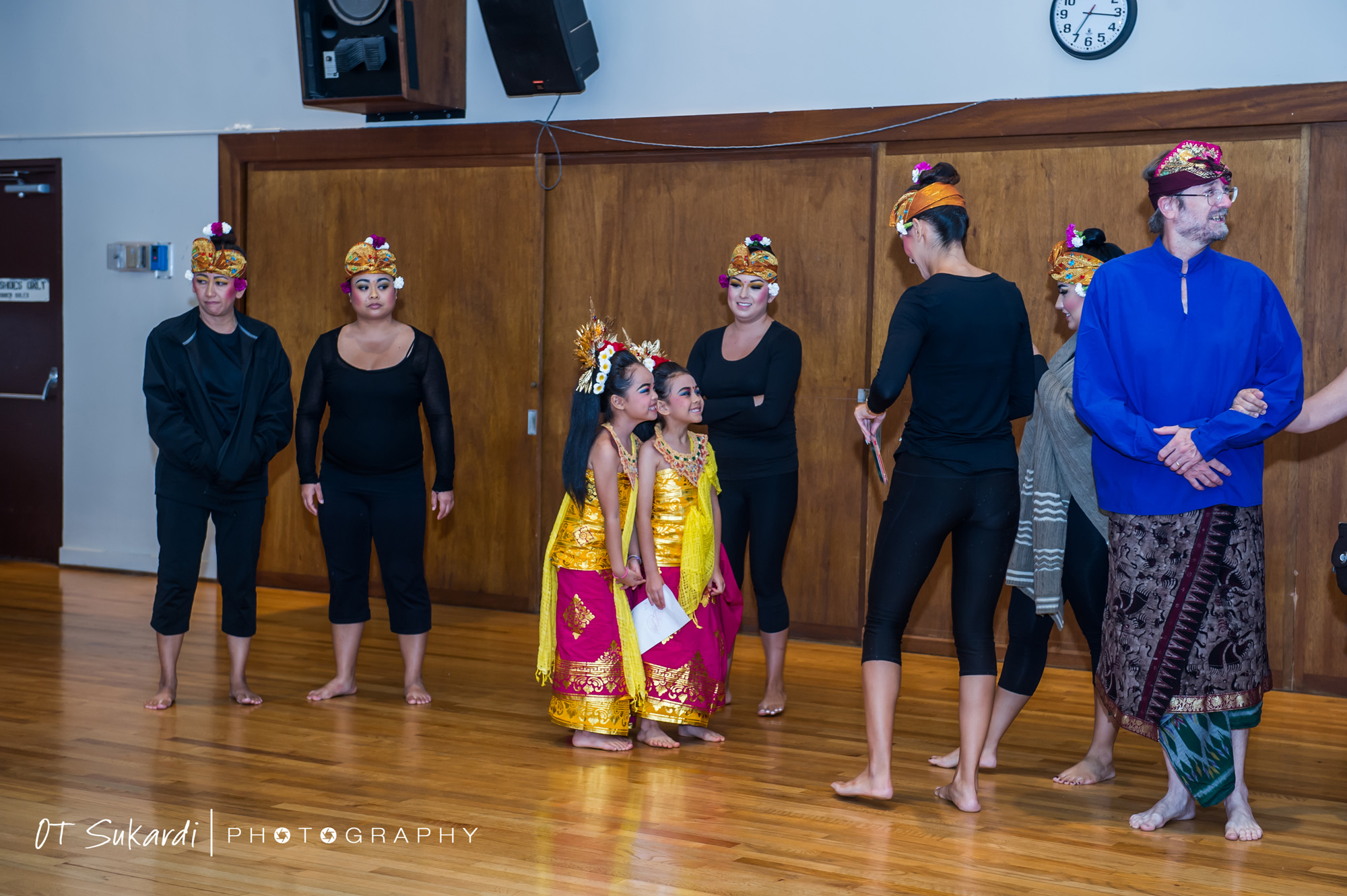 girl performers surrounded by adult performers