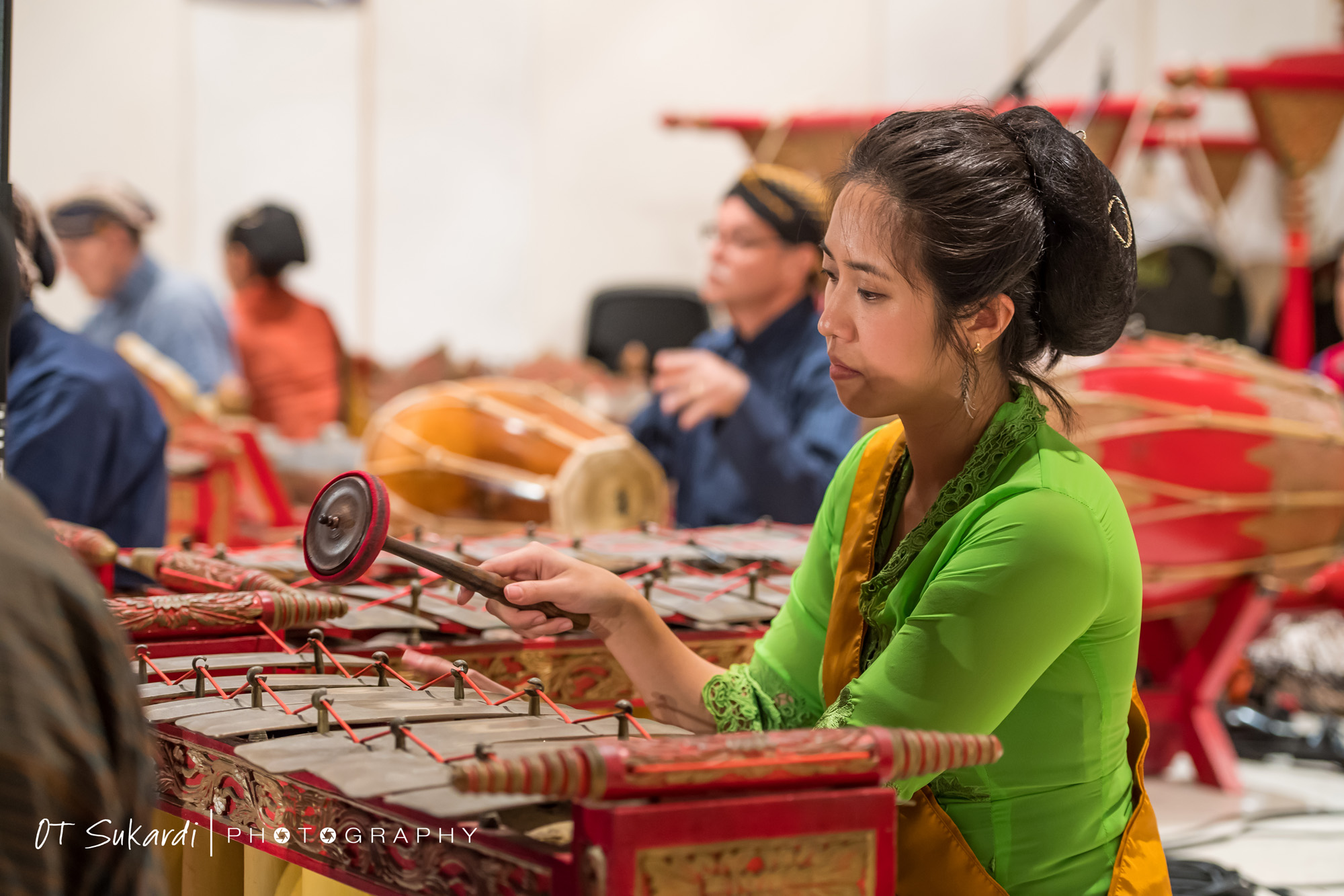close up of woman tapping gamelan keys