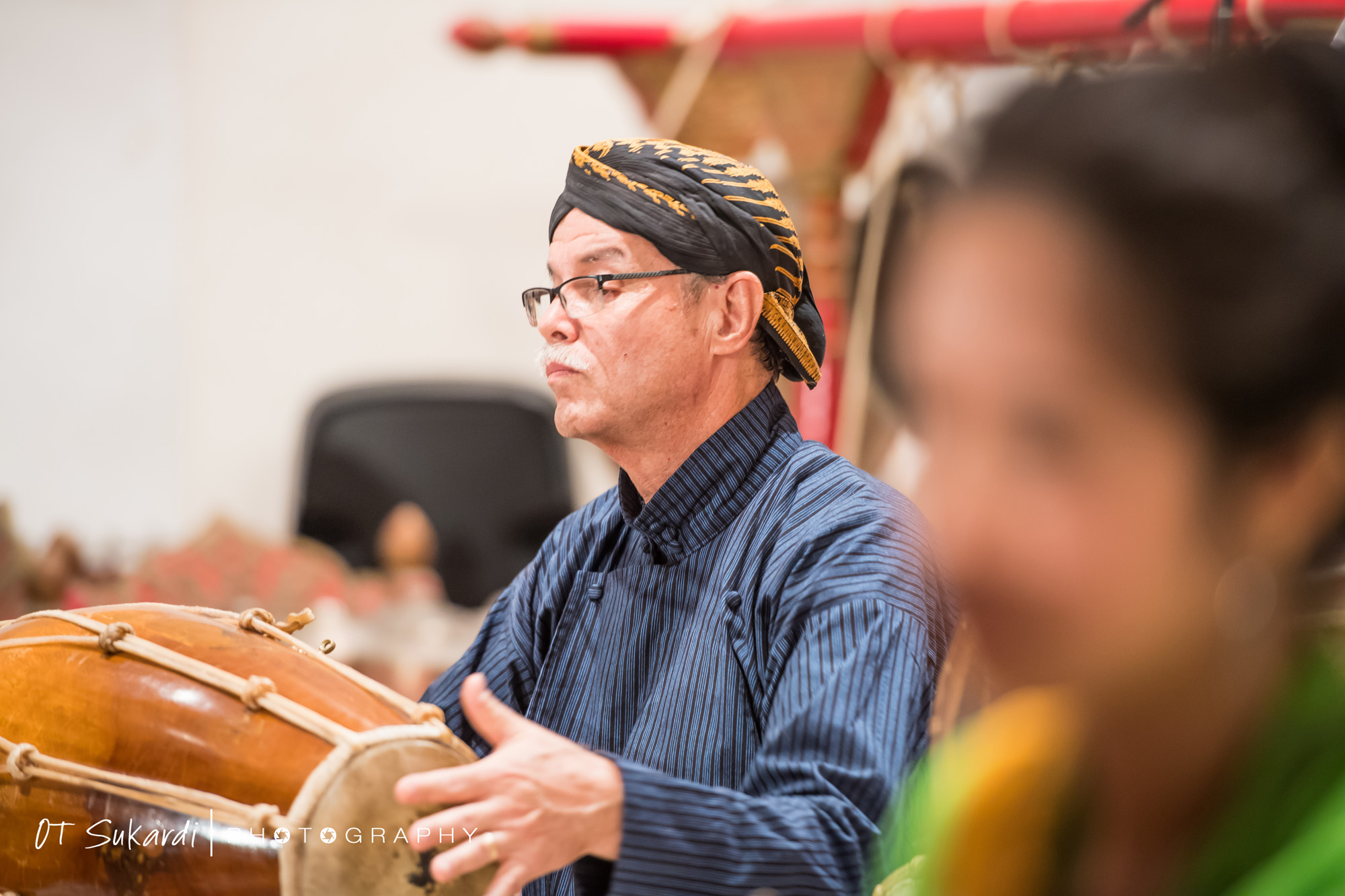 close up of man playing drum