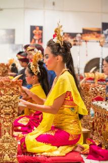 younger and older girl play gamelan